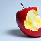 Half eaten red apple by Sami Sarkis