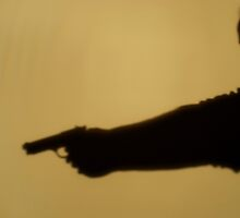 Shadow of man pointing gun, side view, close-up by Sami Sarkis