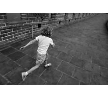 Girl running away on Great Wall of China Photographic Print