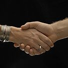 Man and woman shaking hands by Sami Sarkis