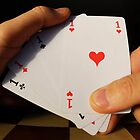 Man holding four Aces cards in hand by Sami Sarkis