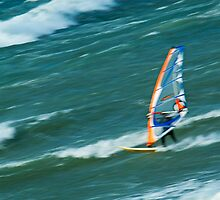 Man windsurfing in sea by Sami Sarkis