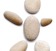 Pebbles arranged in shape of human by Sami Sarkis