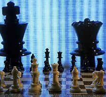 Chess board with King and Queen chess pieces in front of TV screen by Sami Sarkis