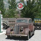 Vintage cars and trucks at vintage service station by Martha Sherman