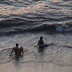 Watching the sunset in the surf of the beach in Puerto Vallarta/Mexico by PtoVallartaMex