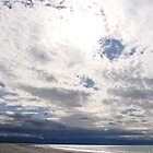 The sun behind the clouds - Nelson beach - New Zealand by jos2507