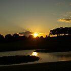 Setting sun over Skogskyrkogården by kostolany244
