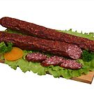 Smoked sausage on wooden board 2 by fotorobs