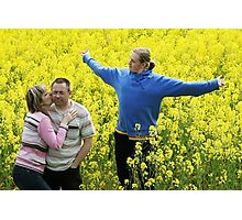 Three people in meadow Photographic Print