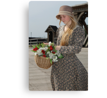 Girl with basket of flowers Canvas Print