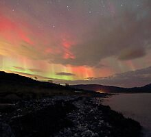 Red Auroras over the beach by Frank Olsen
