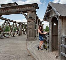 Beauty girl on old-time bridge. by fotorobs