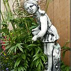 My garden girl wearing a willow hat. by Sandra Foster