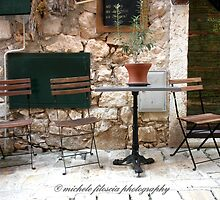 A Table and Chairs by Michele Filoscia