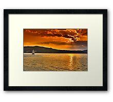 Sailing through the sun Framed Print