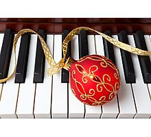 Christmas ornament on piano keys Photographic Print