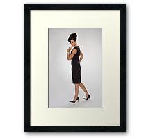Woman in black dress Framed Print