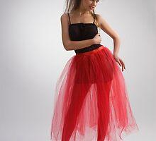 Beautiful girl in red skirt by fotorobs