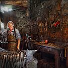 Blacksmith - Working the forge  by Mike  Savad