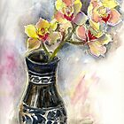 Orchids in black vase by Karin Zeller