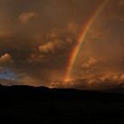 Mountain Silhouette and Rainbow by Noel Elliot