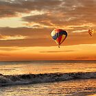 Hot air balloons over sunset beach by Loredana  Smith