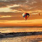 Hot air balloons over sunset beach by Loredana  Smith