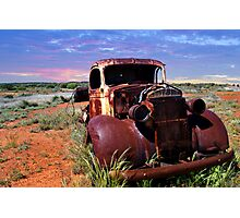 A rusty old pick-up truck in a field Photographic Print