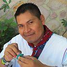 Young and Proud Huichol pasting Beads - Orgulloso Joven Huichol pegando Perlitas  by PtoVallartaMex