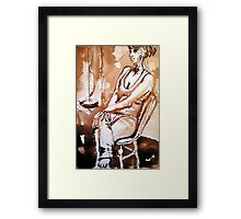 My daughter sitting on a chair Framed Print