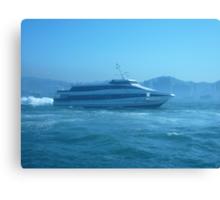A sleek ferry powering along Canvas Print