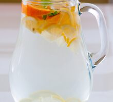 Pitcher with water and fruits by fotorobs