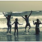 a group of kids jumpin in beach by artsyashi