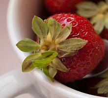 Macro and vibrant colored strawberry by Patrizia  Corriero