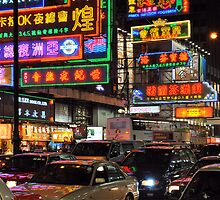 Bustling Hong Kong at night. by Ralph de Zilva