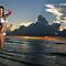 Beautiful brunette bikini model at cloudy Caribbean sunrise by Anton Oparin