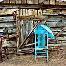 Blue Chair And Parasol by Arla M. Ruggles