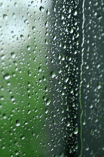 Heavy rain drops on summer window.  Wind of change by Anton Oparin