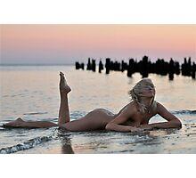 Lovely blond naked model lying on sunset beach at dramatic sunset  Photographic Print