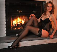 Beautiful tall redhead in lingerie sitting in front of  fireplace  by Anton Oparin