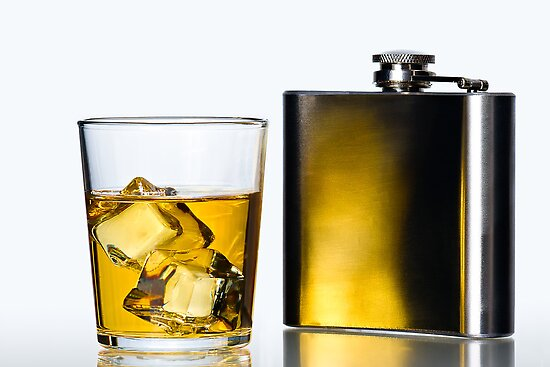 Hip flask and Whisky on the rocks by Gert Lavsen