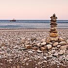 Pebble tower on a beach by David Isaacson