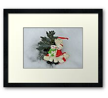 Cute couple with Santa costumes kissing and hugging on Christmas  Framed Print
