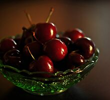 cherries in green dish by Karen E Camilleri
