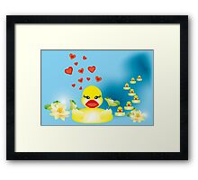 Duck family swimming in lake Framed Print