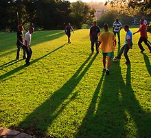 Soccer at sunset by John Finkelde