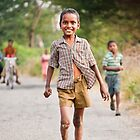 An innocent child, happy in his world, oblivious to the travails around him by Neha Singh