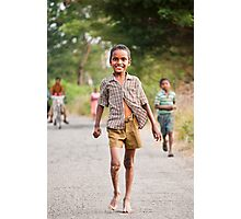 An innocent child, happy in his world, oblivious to the travails around him Photographic Print