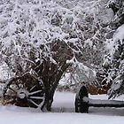 Wheels Covered in Snow by MaeBelle